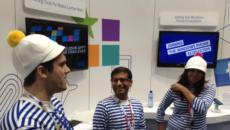 Demonstrators dressed in curious bobble hats staff a Nokia stand at the Mobile World Congress in Barcelona.