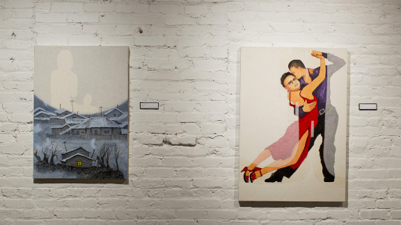 "In ""Hillside Slums,"" the painting on the left, an image of Song"