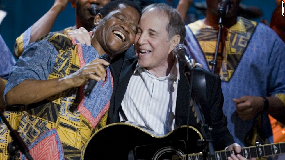 "The band's international breakthrough came in 1986, when American singer Paul Simon (right) featured them on his multi-million selling album"" Graceland."