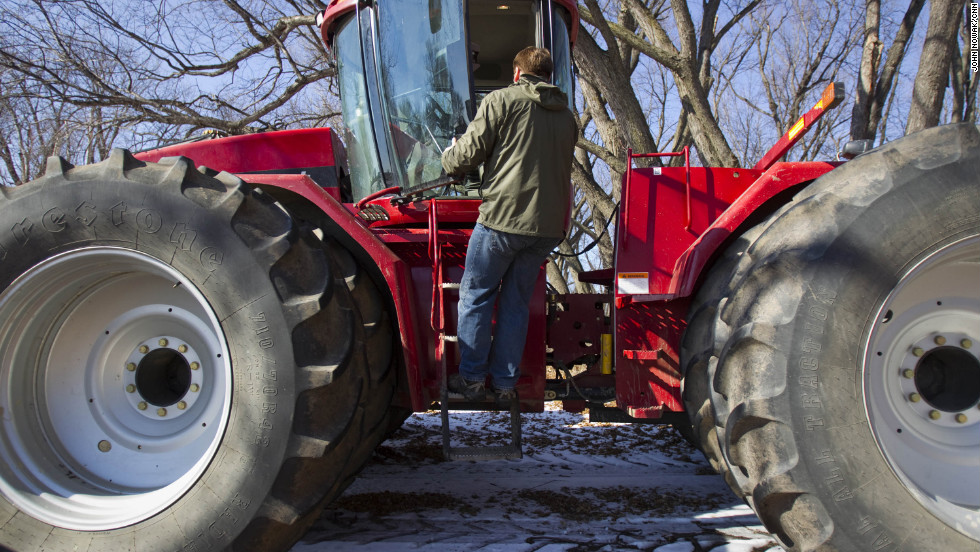 Tofteland climbs into a tractor on his farm. When word came in late October of the MF Global scandal, he thought everything he worked for might be lost.