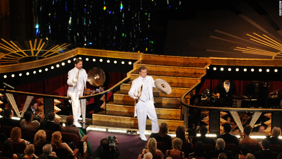 "Wearing matching white tuxedos, Will Ferrell and Zach Galifianakis took the stage playing cymbals. Galifianakis mispronounced his own name while introducing himself, while Ferrell dropped his cymbal trying to open the envelope for best original song. ""Man or Muppet"" from ""The Muppets"" took the award."