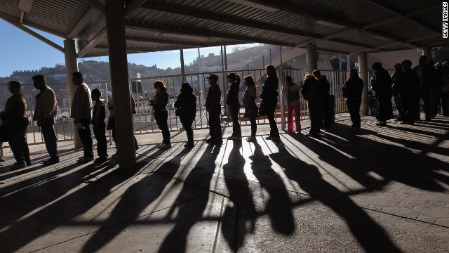 Hundreds of people wait to pass from Mexico into the U.S. at the border crossing  at Nogales, Arizona, on December 10, 2010.