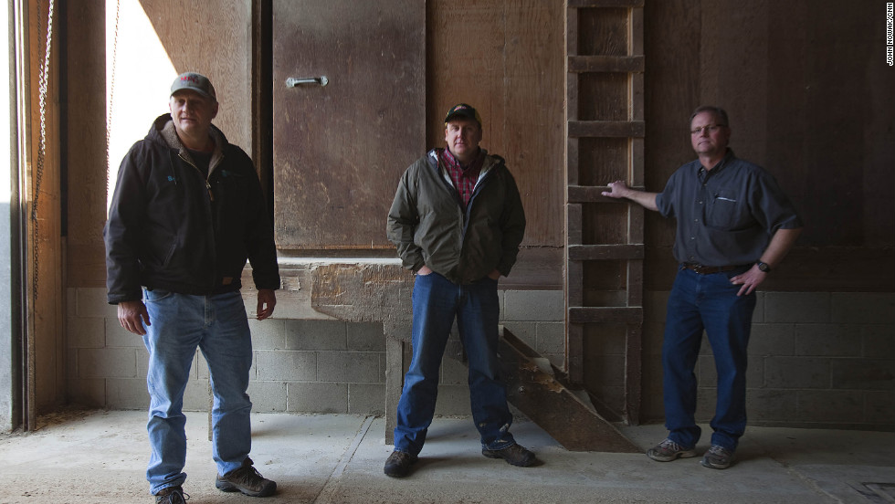 "From left, Brad Mouw, Dean Tofteland and Mike Mouw discuss the MF Global scandal. ""It sucks,"" Mike Mouw says. He and his brother run Mouw's Feed & Grain in Leota, population 222. They had $450,000 taken."
