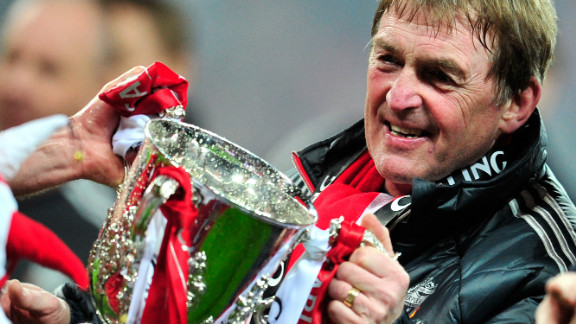 Liverpool manager Kenny Dalglish gets his hands on the English League Cup, the club