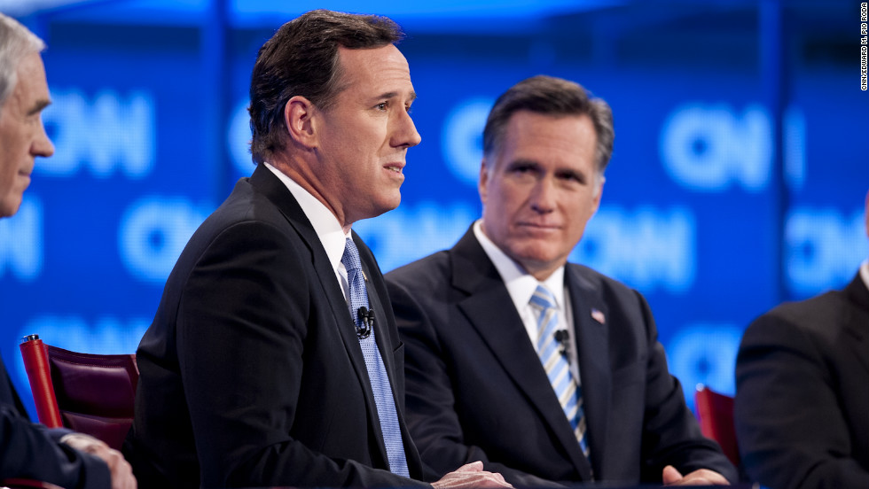 Republican presidential candidates Rick Santorum (left) and Mitt Romney at the CNN Republican Presidential Debate in Mesa, Arizona on February 22, 2012.