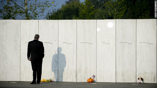 A visitor walks along the Wall of Names during the ceremony marking the 10th anniversary of the crash of United Flight 93 at the Flight 93 National Memorial on September 11, 2011 in Shanksville, Pennsylvania. An estimated crowd of 5,000 watched as the memorial wall was unveiled with the names of the 40 passengers who died when the plane crashed during the terrorist attacks on September 11, 2001.