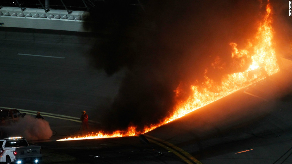 The flames spread across the track, forcing a near two-hour delay to proceedings.