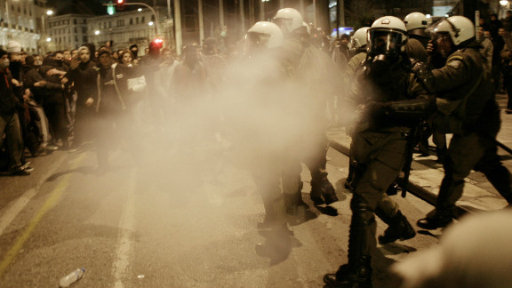 Riot police spray tear gas during a protest against austerity measures on February 19, 2012 in Athens.