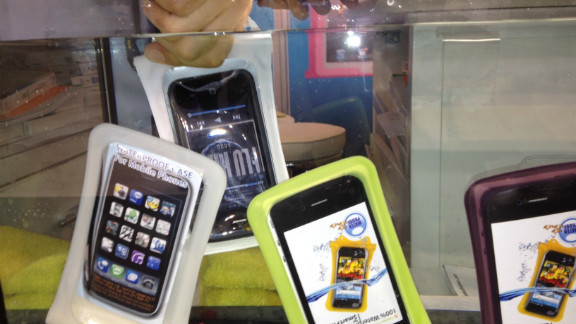 A low-tech solution to waterproofing: Phones are placed in airtight cases made by DiCAPac before being dunked.