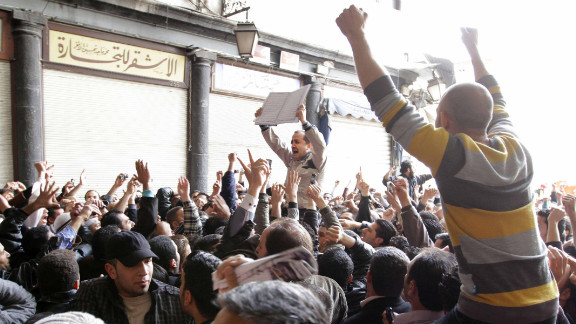 """Hundreds of Syrians march in Damascus in March 2011, chanting """"Daraa is Syria"""" as protests spread throughout the country."""