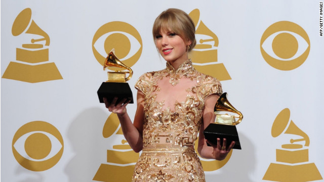 Taylor Swift poses with the trophies for the Best Country Solo Performance 'Mean' and Best Country Song 'Mean' at the 54th Grammy Awards in Los Angeles, California, February 12, 2012.