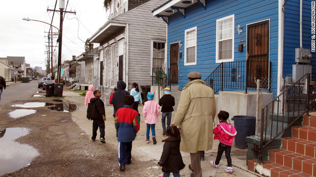 Darryl Durham, head of Anna's Arts for Kids, walks with several children through the Treme neighborhood.