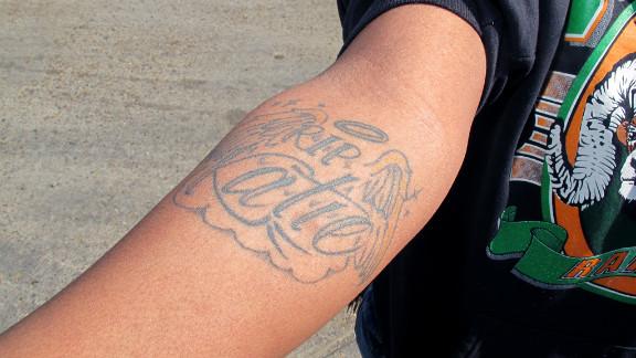 A tattoo memorializes Cee Cee Davis' best friend, who was killed when Davis was 14.