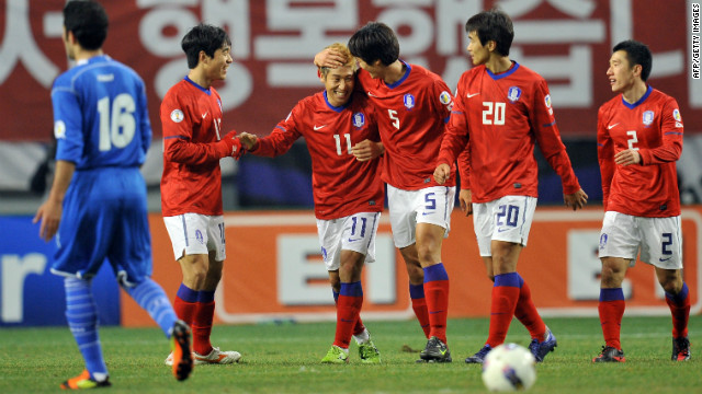 South Korea's players celebrate Lee Keun-Ho's goal in the 2-0 win over Kuwait in Seoul.