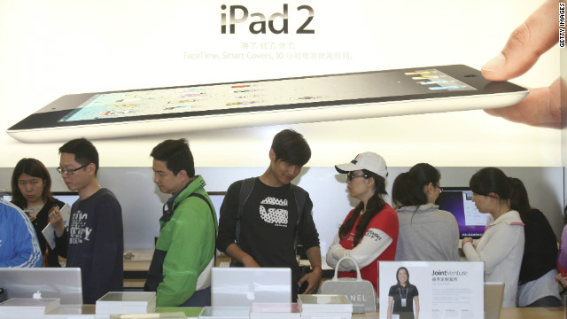 People queue to buy iPad 2 at an Apple store on May 6, 2011 in Shanghai, China.