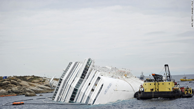 The crippled cruise liner Costa Concordia lies aground near the coast of Italy after striking a reef in January.