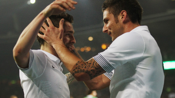 Olivier Giroud (right) of France celebrates with his teammate Mathieu Debuchy after scoring their opener against Germany.  Florent Malouda grabbed the second in a 2-1 win.