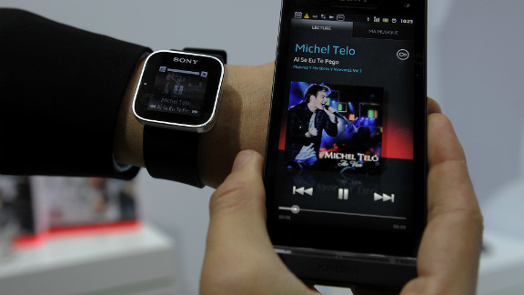 A man displays a Sony SmartWatch conected to a Sony mobile phone during a presentation at the Mobile World Congress on February 28