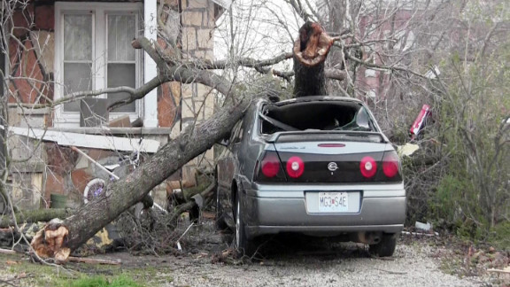 The storm leaves a car battered in the music resort town of Branson, Missouri, in a photo from iReporter Danny Gassaway.