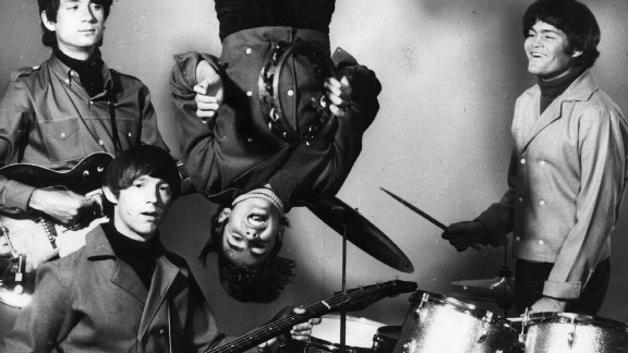 """Jones hangs from a trapeze in 1967. Though the TV show was never a huge ratings hit, its knockabout, Marx Brothers-style comedy -- inspired, to an extent, by the loopier sequences in the Beatles' """"A Hard Day's Night"""" -- gained fans and followers, reigniting the band's popularity when MTV reran the show in the mid-'80s."""