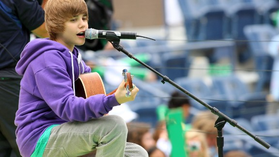 The Stratford, Ontario, native first attracted attention on YouTube. Here Bieber, in his signature purple hoodie, entertains crowds at Arthur Ashe Kids