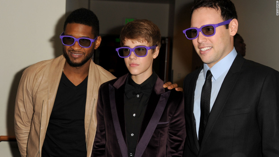 "The pop idol attends the Los Angeles premiere of ""Justin Bieber: Never Say Never,"" a 3-D documentary on his rise to stardom, in February 2011. He's accompanied by Usher and manager Scooter Braun."