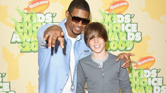 "At 15, Bieber had yet to become synonymous with the ubiquitous single ""Baby."" At this point, he was soaking up all he could learn from his mentor, Usher, with whom he attended the Nickelodeon Kids"