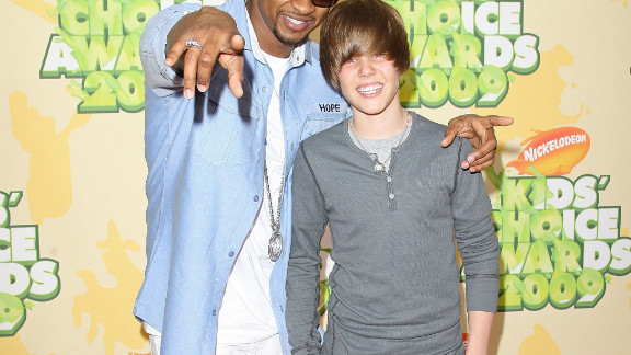 """At 15, Bieber had yet to become synonymous with the ubiquitous single """"Baby."""" At this point, he was soaking up all he could learn from his mentor, Usher, whom he attended the Nickelodeon Kids' Choice Awards in March 2009."""