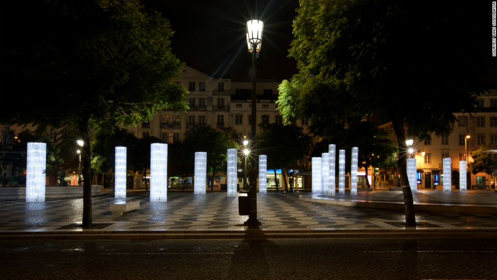 "These ethereal ""Frozen Trees,"" installed at a plaza in downtown Lisbon, Portugal, are made from thousands of IKEA plastic bag dispensers. Designers ""LIKE Architects"" turned the prosaic objects into 30 LED-illuminated street lights."