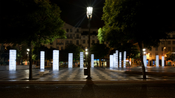 """These ethereal """"Frozen Trees,"""" installed at a plaza in downtown Lisbon, Portugal, are made from thousands of IKEA plastic bag dispensers. Designers """"LIKE Architects"""" turned the prosaic objects into 30 LED-illuminated street lights."""