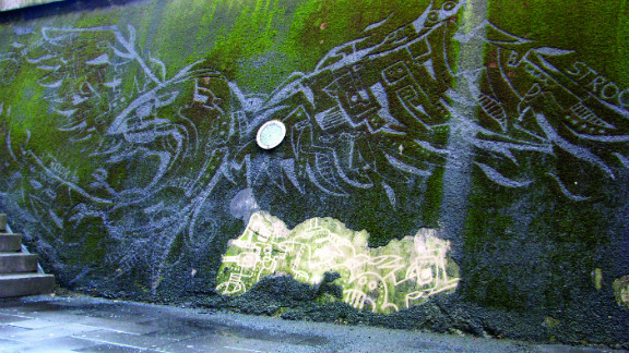 """Belgian graphic designer Strook used a moss-covered wall in his home city of Leuven as a canvas -- employing a power-washer to create what he calls """"reverse graffiti."""" He created this bird mural by cleaning  moss off, rather than spraying paint on. """"A filthy wall became something attractive,"""" he says. I hope some people will look at the wall in a different way and discover the beauty of nature."""""""