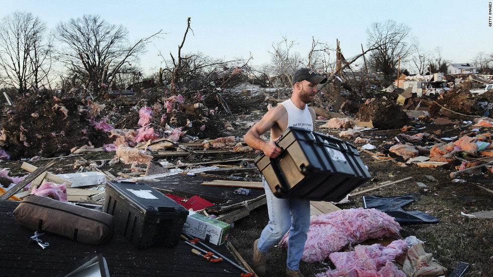 Josh Summers searches for his possessions after the tornado ripped through his Harrisburg neighborhood. The twister appeared to have been on the ground for several miles, a city official said.