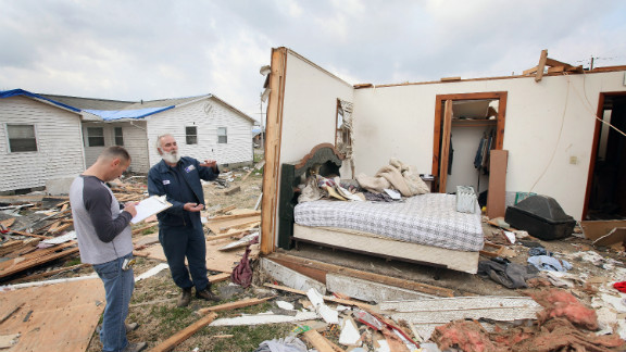 Keith Huke, right, remained in the bed to his left, escaping with no injuries from the tornado that tore apart his home in Harrisburg, Illinois.