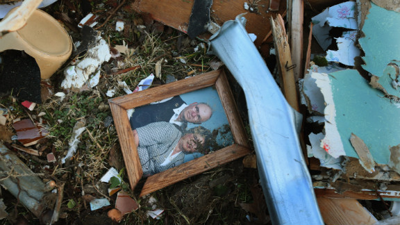 A family portrait sits among the debris of a Henryville home.