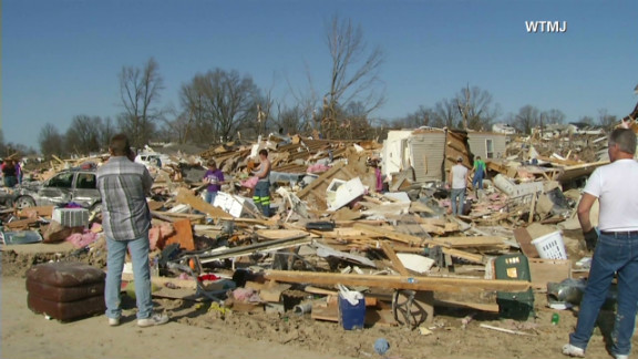 A tornado swept through Henryville, Indiana, 20 miles north of Louisville, leveling neighborhoods, sending school buses into buildings and demolishing businesses.