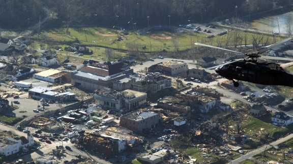 A helicopter carrying Kentucky Gov. Steve Beshear flies over the battered town of West Liberty.