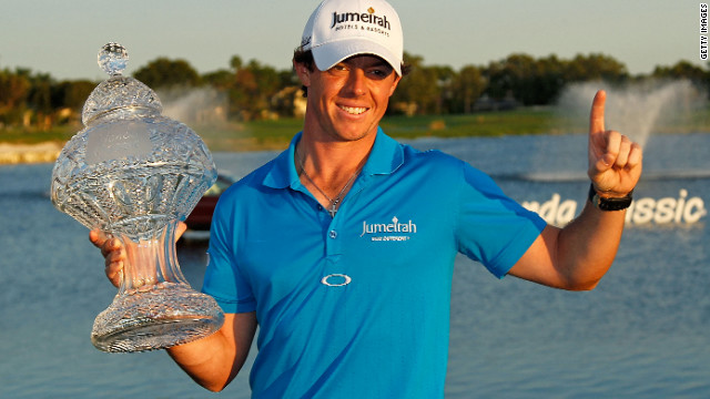 Rory McIlroy holds the trophy aloft after winning the Honda Classic in Florida.