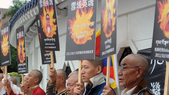Tibetans display portraits of people who killed themselves in self-immolation, during a protest in front of the Liberty Square in Taipei in October 2011.