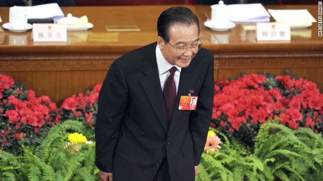 Chinese Premier Wen Jiabao bows to delegates during the opening session of the National People's Congress in Beijing Monday.