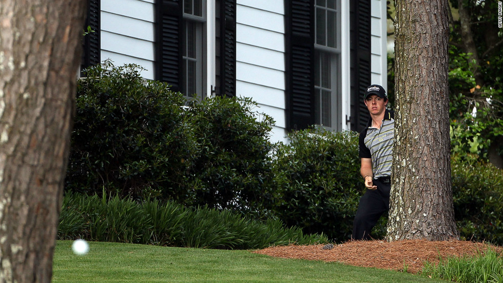 "<a href=""http://edition.cnn.com/2011/SPORT/golf/04/10/golf.masters.schwartzel.woods/index.html"">Masters disaster</a>. McIlroy chips out from the trees on the 10th hole during the final round of the 2011 Masters at Augusta National Golf Club. He sqaundered a four-shot lead in the final round to eventually finish in a tie for 15th."