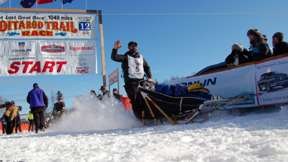 Bundle up: Iditarod spectators must brave Alaskan weather to get a glimpse of their favorite teams.