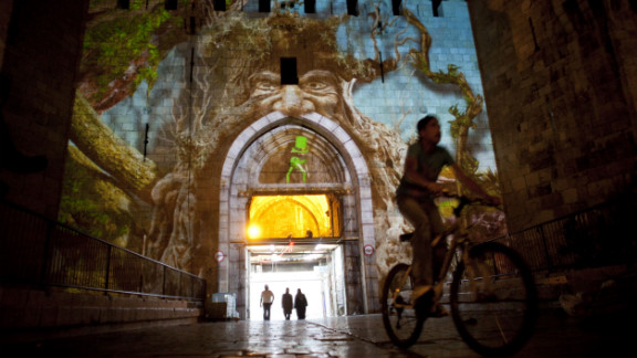 A Palestinian boy rides past the Damascus gate during the Jerusalem Festival of Lights last June.