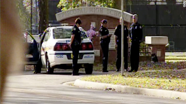 Police arrive on the scene at Episcopal High School, where police said the headmistress was killed by a fired employee.
