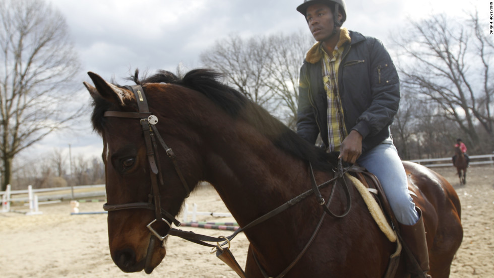 Rhyheem Cauley works out his horse on a recent blustery Saturday afternoon. Cauley, 19, used to visit the Chamounix Equestrian Center to watch the horses when he was younger. He spent five years in the program.