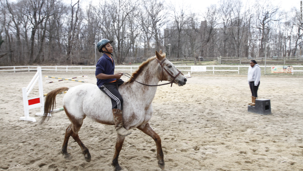Saddiq Myers, 13, rides one of the stable ponies around the paddock at the Chamounix Equestrian Center in Philadelphia's Fairmount Park. Myers is entering his fourth year with Work To Ride. His sisters, Sihgerra, 14, and Sudayaah, 9, also participate in the program.