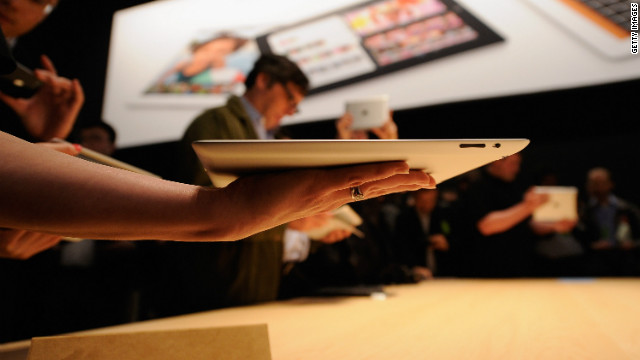 Members of the media test Apple's new iPad tablet at a launch event March 7 in San Francisco.