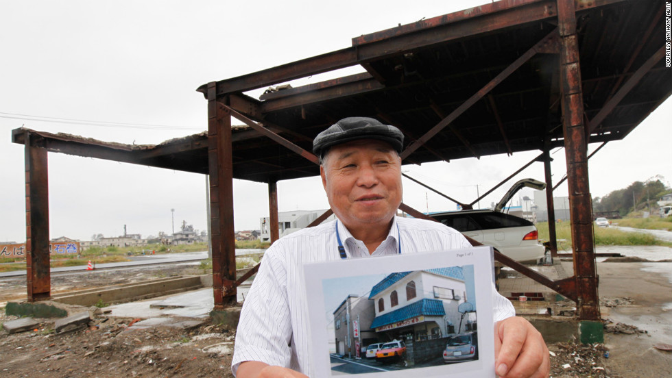 "Seiki Sano, 81, stands where his home once stood in Sendai, Japan. It was destroyed in March 2011 in a devastating earthquake and tsunami. The fisherman also lost both of his boats in the tsunami. ""It's hard to rebuild,"" he told iReporter Anthony Altit. ""I won't live to see it happen."""