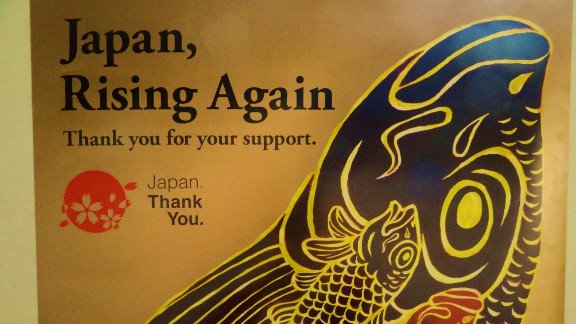"Allan Cook, a British expat living in Japan, said posters like this one have started to crop up around the city of Akihabara. ""The simple 'thank you' really makes a strong and meaningful impact,"" he said."