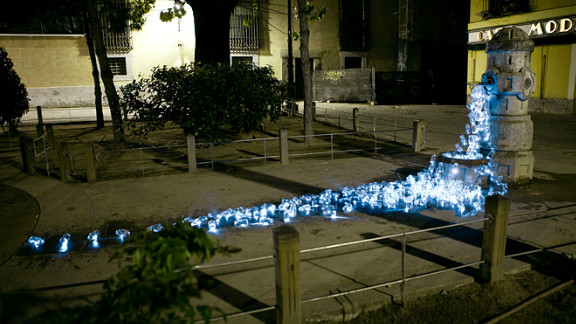 Spanish art collective Luzinterruptus recently created a temporary installation of recycled glass containers streaming from dismantled public fountains in the streets of Madrid. They say the luminous works of art is are interventions -- designed not only to look beautiful, but to bring attention to the lack of water facilities in public spaces in Spain