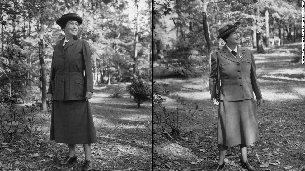 Captioned in LIFE: Daisy Gordon Lawrence wearing old and new Girl Scout uniforms when the pictures ran in LIFE: (Left) First uniform officially approved was severe, military and khaki-colored. (Right) New uniform for leaders, designed by Mainbocher, is green but still severe.